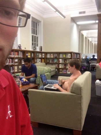 Studying for finals in the library, drinking beer and shirtless